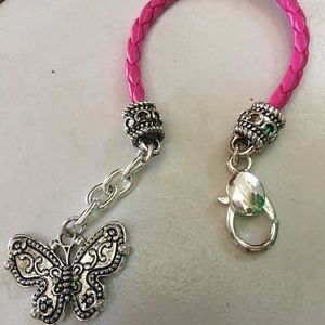 Jewelry - Pink leather braided bracelet with charm